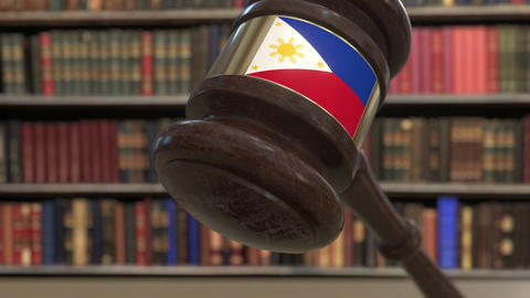 Flag of Philippines on falling judges gavel in court. National justice or Live Action