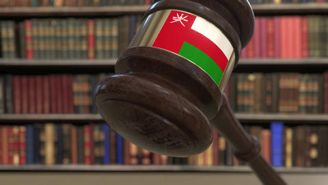 Flag of Oman on falling judges gavel in court. National justice or jurisdiction Live Action