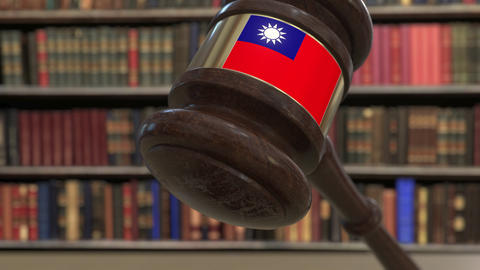 Flag of Taiwan on falling judges gavel in court. National justice or Live Action