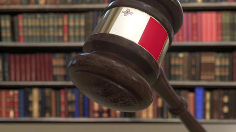Flag of Malta on falling judges gavel in court. National justice or jurisdiction Live Action
