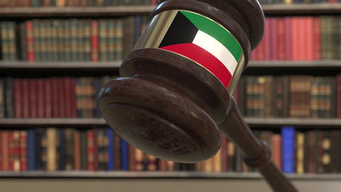 Flag of Kuwait on falling judges gavel in court. National justice or Live Action