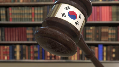 Flag of South Korea on falling judges gavel in court. National justice or Live Action