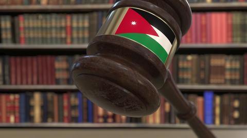 Flag of Jordan on falling judges gavel in court. National justice or Live Action