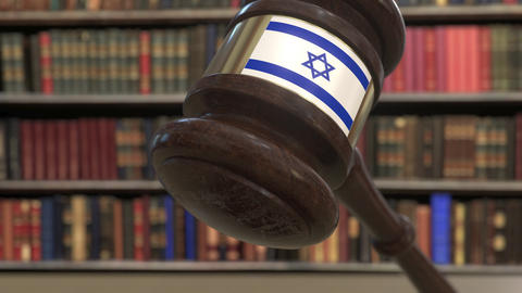 Flag of Israel on falling judges gavel in court. National justice or Live Action