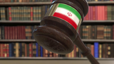 Flag of Iran on falling judges gavel in court. National justice or jurisdiction Live Action