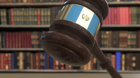 Flag of Guatemala on falling judges gavel in court. National justice or Live Action