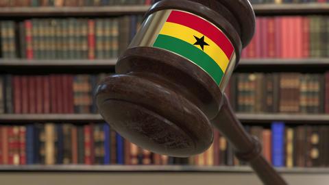 Flag of Ghana on falling judges gavel in court. National justice or jurisdiction Live Action
