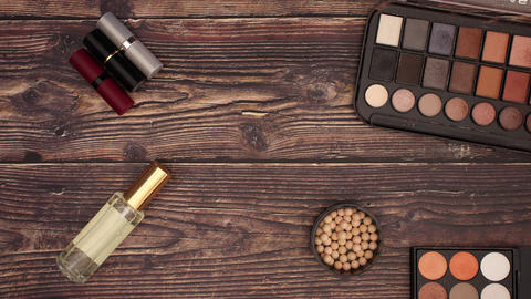 Eye Shadow Lipstick and makeup products on the deck - Stop motion animation Animation
