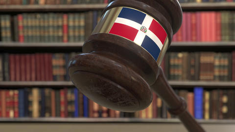 Flag of the Dominican Republic on falling judges gavel in court. National Live Action