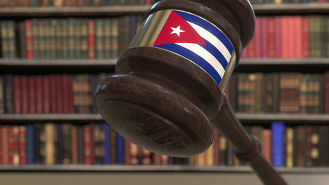Flag of Cuba on falling judges gavel in court. National justice or jurisdiction Live Action