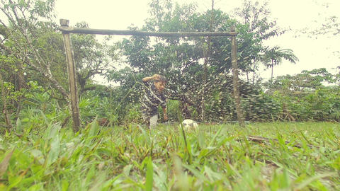 Indigenous Kid Playing Soccer In The Rain In The Amazon Rainforest Live Action