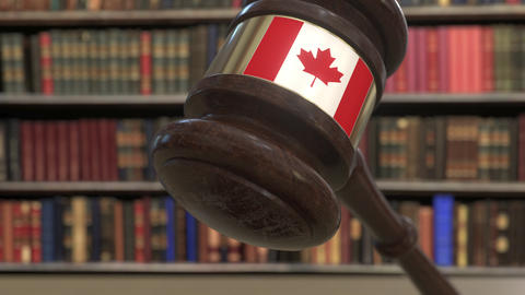 Flag of Canada on falling judges gavel in court. National justice or Live Action