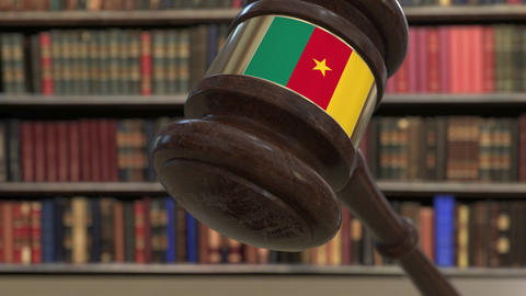 Flag of Cameroon on falling judges gavel in court. National justice or Live Action