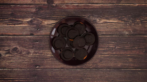 Jaffa cake on wooden table - Stop motion Animation