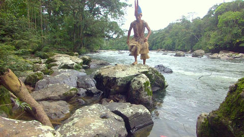 Indigenous Hunter Jumping On The Stones In The Amazon Rainforest Footage