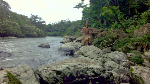 Indigenous Hunter Running On The Stones At The Edge Of A River Footage