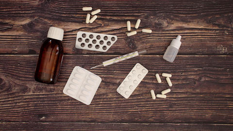Pills and medicine on wooden table - Stop motion Animation