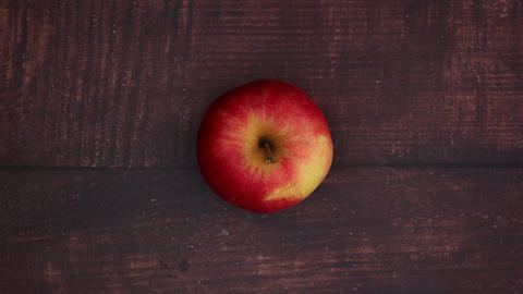 Red apple on wooden table - Stop motion Animation
