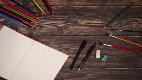School Supplies on wooden background - Stop motion Animation
