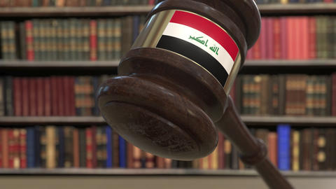 Flag of Iraq on falling judges gavel in court. National justice or jurisdiction Live Action