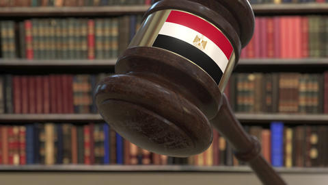 Flag of Egypt on falling judges gavel in court. National justice or jurisdiction Live Action