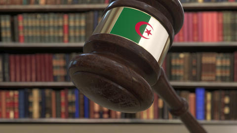 Flag of Algeria on falling judges gavel in court. National justice or Live Action
