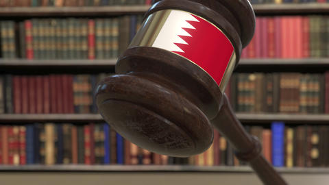 Flag of Bahrain on falling judges gavel in court. National justice or Live Action