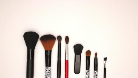Brush and eye shadow tools on white background - Stop motion animation Animation