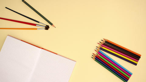 School Supplies on yellow background - Stop motion animation Animation