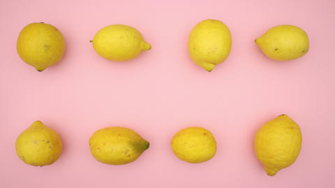 Lemons moving on pink background - Stop motion animation video Animation