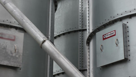 Factory equipment. Steel water tanks stand in open air Footage