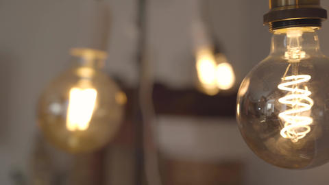 Tungsten light bulb lamp close-up. Concept of light, idea, electricity at modern Footage