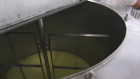 Factory making process. Milk whey and curd mix in tank at farm factory Footage