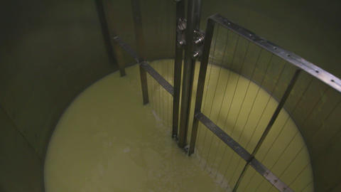 Factory making process. Milk whey and curd mix in mixing machine at farm factory Live Action