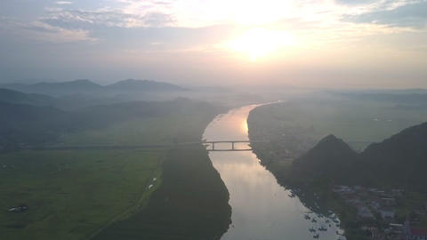 fantastic valley crossed by calm wide river and narrow road Footage