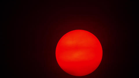 Red sun sphere in thick smog Live Action