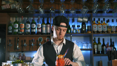 The bartender is preparing an alcoholic cocktail Live Action