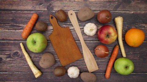 Cutting board wooden spoon fruits and vegetables on the deck - Stop Motion Animation