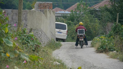 Motorcycle traveling on country road Stock Video Footage