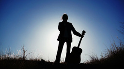 Silhouette of Girl and a Guitar Stock Video Footage