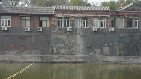 Old house of Beijing moat.floats ball on lake.Water surface Stock Video Footage