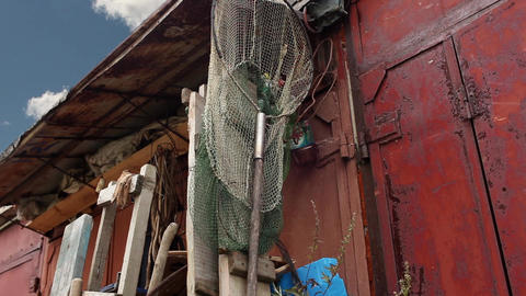 Fishing net on red wall Stock Video Footage