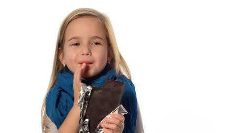 little girl a blonde eats a chocolate Stock Video Footage