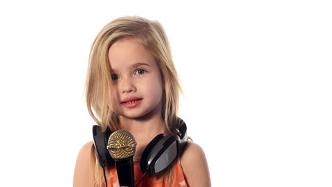 baby, little girl with a microphone Stock Video Footage