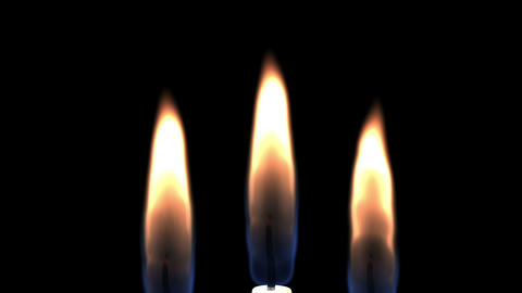 Three Candles Burning And Camera Movement Stock Video Footage