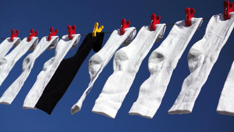 White Black Socks Blowing in Wind Stock Video Footage
