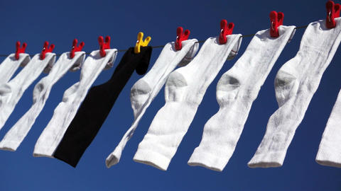 White Black Socks Blowing In Wind stock footage