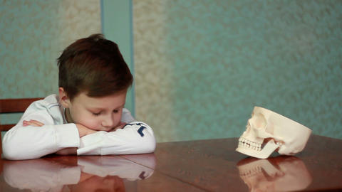 Boy plays with skull 3 Stock Video Footage
