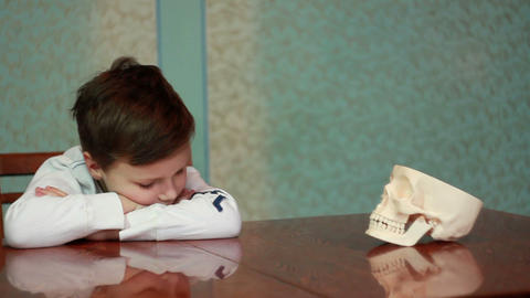 Boy Plays With Skull 3 stock footage