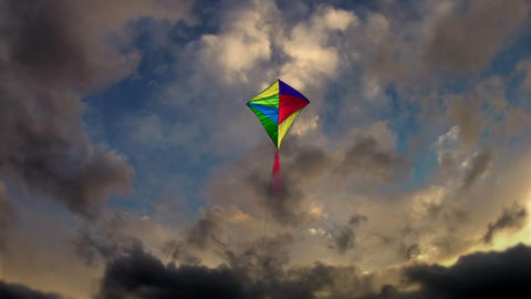 Kite Flying in the cloudy dark sky Stock Video Footage